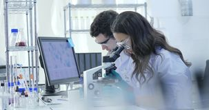 Dolly Shot of Medical Research Scientists Team Work on Modern Laboratory with Scientists Conducting experiments, Working