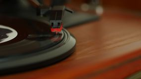 Dolly shot of a needle on a record. Dolly shot, shows a needle on a record in 4k stock video