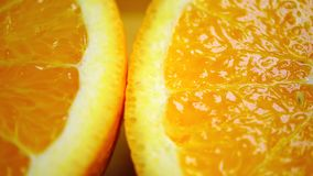 Dolly shot of orange halves, macro video stock footage