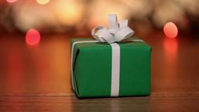 Dolly shot of present box against blurry lights stock footage