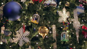 A dolly shot shot of a decorated Christmas. Christmas tree with Colorful bokeh and christmas lights stock footage