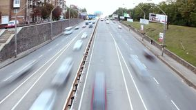 Dolly shot timelapse city traffic, cars drive under bridge, day. Stock footage stock video footage