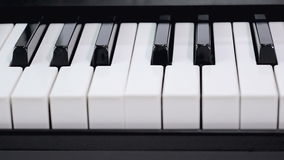 Dolly slider close shot shallow depth of field piano keyboard electric keyboard musical instrument black and white key. Dolly slider close shot shallow depth of stock video footage