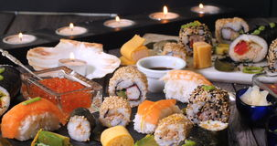 Dolly view of an assortment of Japanese food: sushi, nigiri, sashimi. Rolls stock footage