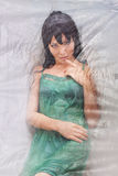 Dolly Woman covered with Cellophane and alluring e Stock Images