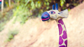 Dolly wooden giraffe on colorful background Royalty Free Stock Photography