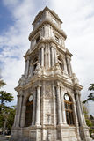 Dolmabahce clock tower in Istanbul. Turkey. Royalty Free Stock Images