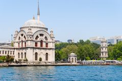 Dolmabahce Mosque. Famous historical structure of Istanbul and a view from the sea. Dolmabahce district. Istanbul. Turkey stock images