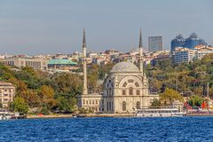 Dolmabahce Mosque. ISTANBUL, TURKEY - SEPTEMBER 29, 2013: Tourist ship crusing around Dolmabahce Mosque Royalty Free Stock Photo