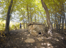 Dolmen in Adygea. Tourist photographer make picture of ancient megalithic dolmen in Adygea, Russia Stock Images