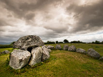 Dolmen, Carrowmore, Ireland. These stones form a l dolmen (a tomb) and are typical in Ireland, captured with a nice stormy sky. Located in Carrowmore Stock Image