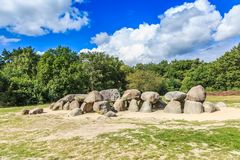 Dolmen D53 in the province of Drenthe. A dolmen, D53,  in the province of Drenthe in the Netherlands with a background of oak trees and a beautiful Dutch cloudy Royalty Free Stock Photos