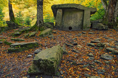 Dolmen in the forest. Ancient portal dolmen standing in scenic forest Royalty Free Stock Photos