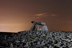 Dolmen named Chabola de la Hechicera, in Elvillar, Alava, Spain. Long exposure at night Stock Photography