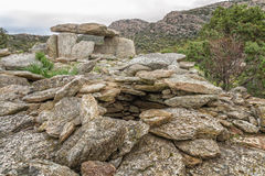 Dolmen at Revincu in Corsica. Prehistoric Dolmen (burial site) at Revincu in the Desert des Agriates in northern Corsica Royalty Free Stock Photography