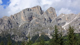 Dolomite alps. High mountains in Italy with some trees in the foreground Royalty Free Stock Photos