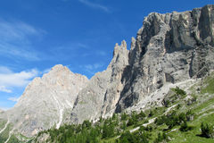 Dolomite Alps beautiful rocky peaks and green slopes Royalty Free Stock Photos