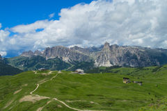 Dolomite Alps green valley and mountain road Royalty Free Stock Photos