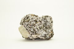 Dolomite with chalcopyrite and Calcite. A large calcite crystal on a cluster of dolomite and chalcopyrite. Isolated on white, some shadow Royalty Free Stock Photography