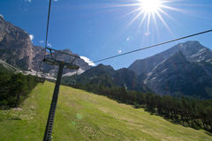 Dolomites. Chair lift in dolomites next to Antelao Mountain Stock Photography