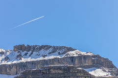 Dolomites Alps mountains peak in spring in Italy near Madonna di Campiglio with clear sky and plane stock images