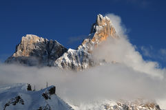 Dolomites Alps, South Tyrol, Italy. Cimon della Pala or Cimone with clouds in the Pale di San Martino Group. Royalty Free Stock Photography