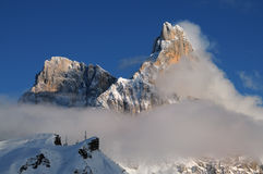 Dolomites Alps, South Tyrol, Italy. Cimon della Pala or Cimone with clouds in the Pale di San Martino Group. Stock Photo