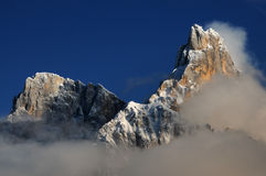 Dolomites Alps, South Tyrol, Italy. Cimon della Pala or Cimone with clouds in the Pale di San Martino Group. Stock Photography