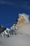 Dolomites Alps, South Tyrol, Italy. Cimon della Pala or Cimone with clouds in the Pale di San Martino Group. Stock Photos