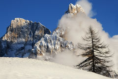 Dolomites Alps, South Tyrol, Italy. Cimon della Pala or Cimone with clouds in the Pale di San Martino Group Stock Images