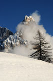 Dolomites Alps, South Tyrol, Italy. Cimon della Pala or Cimone with clouds in the Pale di San Martino Group Royalty Free Stock Photo