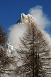 Dolomites Alps, South Tyrol, Italy. Cimon della Pala or Cimone with clouds in the Pale di San Martino Group Stock Photography