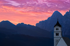 Dolomites Church Colle Santa Lucia at sunrise, Alps, Italy Stock Photos