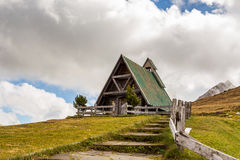 Dolomites cottage in Passo Giau Stock Photos