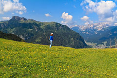 Dolomites - hiker on meadow Royalty Free Stock Photos
