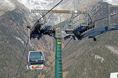 Dolomites , Italy - December 23, 2015: Nebelhorn cable car moving up Mountain in winter time. The offers close views of. Dolomites , Italy - December 23, 2015 Royalty Free Stock Images
