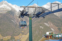 Dolomites , Italy - December 23, 2015: Nebelhorn cable car moving up Mountain in winter time. The offers close views of. Dolomites , Italy - December 23, 2015 Stock Photography
