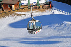 Dolomites , Italy - December 23, 2015: Nebelhorn cable car moving up Mountain in winter time. The offers close views of. Dolomites , Italy - December 23, 2015 Stock Photo