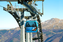 Dolomites , Italy - December 23, 2015: Nebelhorn cable car moving up Mountain in winter time. The offers close views of. Dolomites , Italy - December 23, 2015 Stock Image