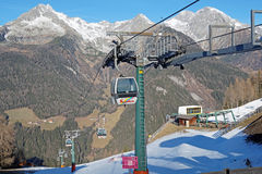 Dolomites , Italy - December 23, 2015: Nebelhorn cable car moving up Mountain in winter time. The offers close views of. Dolomites , Italy - December 23, 2015 Stock Images