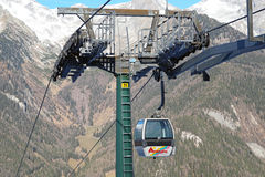 Dolomites , Italy - December 23, 2015: Nebelhorn cable car moving up Mountain in winter time. The offers close views of. Dolomites , Italy - December 23, 2015 Stock Photos