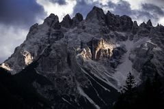 Dolomites, Italy, mountains between the regions of Veneto and Alto Adige. Peaks of the Dolomites mountains illuminated by the sun with golden reflections royalty free stock images
