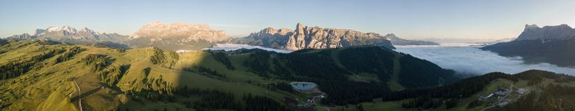 Dolomites, Italy, Sud Tirol. Drone aerial view of the fog at the bottom of the valley in summer time. Dolomites, Italy, Alta Badia, Sud Tirol. Drone aerial view royalty free stock image
