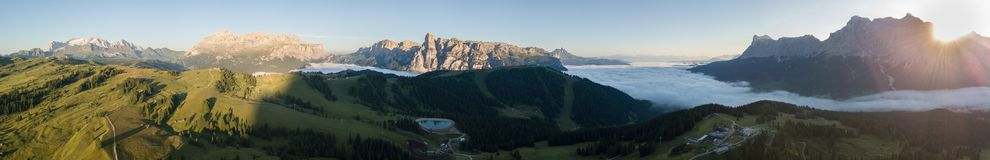 Dolomites, Italy, Sud Tirol. Drone aerial view of the fog at the bottom of the valley in summer time. Dolomites, Italy, Alta Badia, Sud Tirol. Drone aerial view stock photos