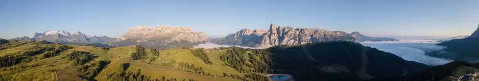 Dolomites, Italy, Sud Tirol. Drone aerial view of the fog at the bottom of the valley in summer time. Dolomites, Italy, Alta Badia, Sud Tirol. Drone aerial view stock images