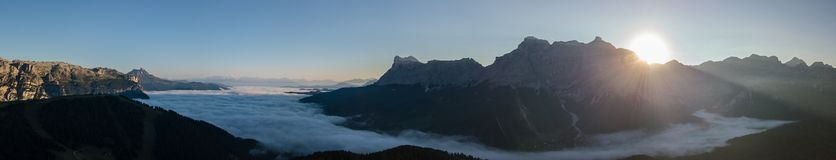 Dolomites, Italy, Sud Tirol. Drone aerial view of the fog at the bottom of the valley in summer time. Dolomites, Italy, Alta Badia, Sud Tirol. Drone aerial view stock image