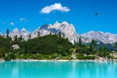 Dolomites - Lago di Sorapis. Dolomites. Lago di Sorapis. Turquoise water, beautiful views. Tre Cime di Lavaredo in the background Royalty Free Stock Photography