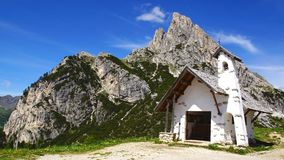 Dolomites  landscape with ancient chirch. Dolomites landscape with ancient chirch. Pass Falzarego, Italy Royalty Free Stock Image