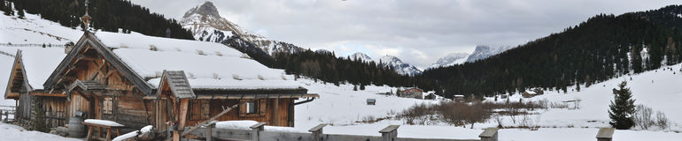 Dolomite mountain and huts panorama. Dolomite winter panorama of typical hut Stock Photography