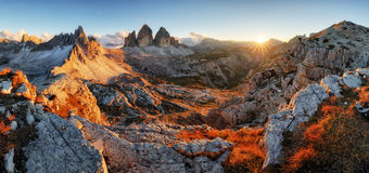 Dolomites mountain panorama in Italy at sunset - Tre Cime di Lav stock photography